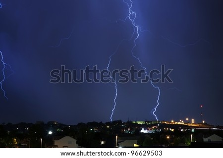 Electric Storm Above the City. Night Stormy Sky. Severe Weather Photo Collection.