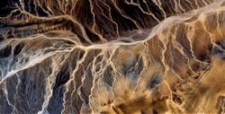 electric storm, allegory, tribute to Pollock, abstract photography of the deserts of Africa from the air,aerial view, abstract expressionism, contemporary photographic art, abstract naturalism,