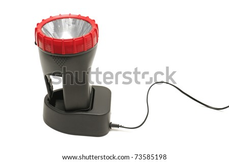 electric torch and charging device isolated on a white background