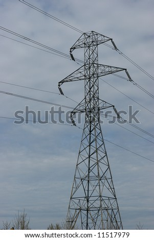Electric Tower against a Cloudy Sky