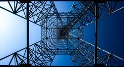 Electric tower bottom view. High technology blue background. Square, geometric shapes.