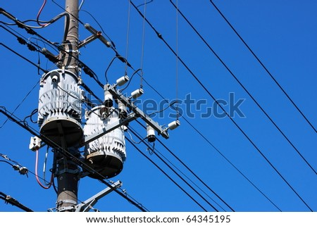Electric transformer on blue sky