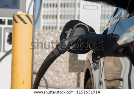 Electric vehicle being charged at the charging station #1151631914