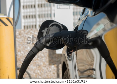 Electric vehicle being charged at the charging station #1151631917