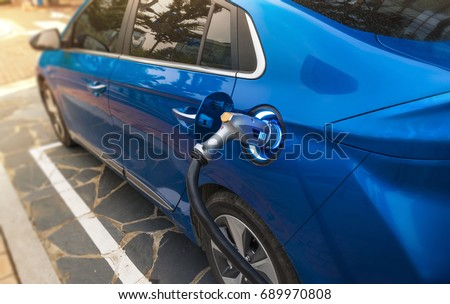 Electric Vehicle Charging #689970808