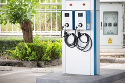 electric vehicle charging (Ev) station with plug of power cable supply for Ev car. Nfc payment. Smart enegy.