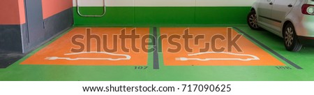 Electric vehicle charging station and parking stall sign paint on asphalt