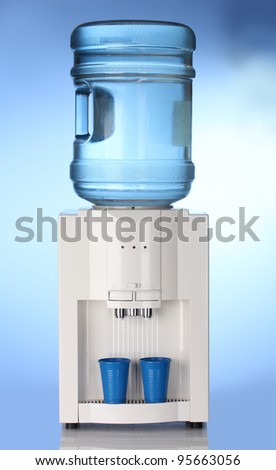 Electric water cooler on blue background