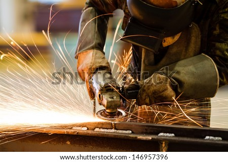 Shutterstock Electric wheel grinding on steel structure in factory