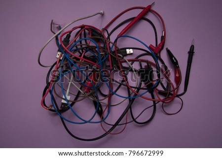 electric wire, isolated on a lilac background. many colored wires. insecure  #796672999