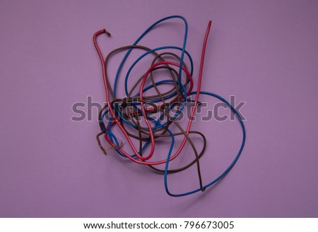 electric wire, isolated on a lilac background. many colored wires. insecure  #796673005