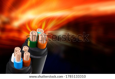 Electric wire on fire background. Copper wire is the electrical conductor of the city society. Foto stock ©