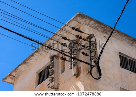 Electric wires. Wires on the wall of the house. #1072478888