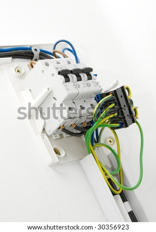 Electric wiring on white wall in a house
