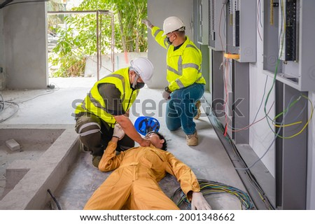 Electric worker suffered an electric shock accident unconscious. Safety team CPR for first aid Electric worker loses in electric shock accident at work on site. Accident in control room of factory.