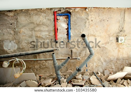 electrical and plumbing installation in kitchen interior construction
