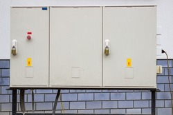 electrical cabinet with warning signs and padlocks at a street