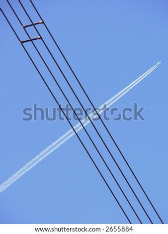 Electrical cable crosse by the smoke track of a jumbo Stok fotoğraf ©