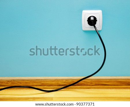 Electrical cable into the socket. Home shot. #90377371