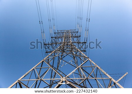 Electrical  Cables Tower Blue Electrical high voltage powerlines tower metal structure attached cables in blue sky