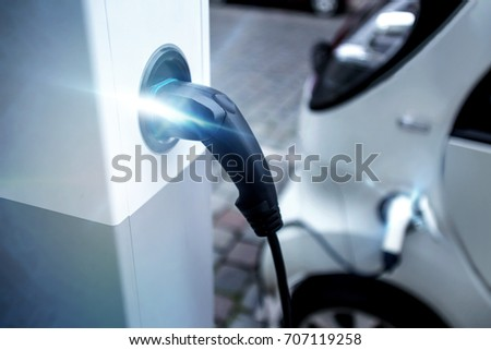 electrical car charging on a charging pillar