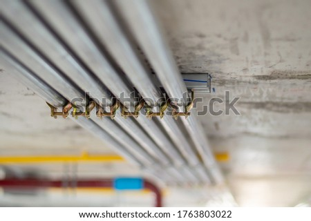 Electrical conduit for cable routing between electrical distribution panel with  Pipe of electricity line installed in buildings. Selective focus. Stock photo ©