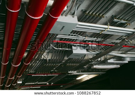 Electrical conduits system and metal pipeline installed on building ceiling. Stock photo ©