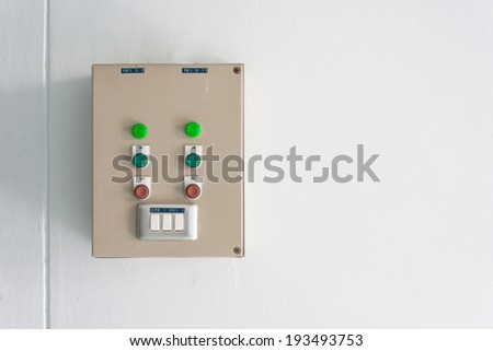 electrical control and light switch on white wall