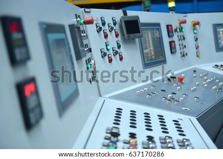 Electrical control panel with buttons and levers