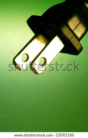electrical cord against green background