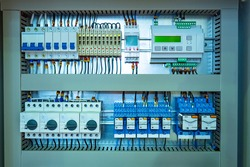 Electrical distribution cabinet with many automatic devices. Metal electrical cabinet close-up. Electrification control panel. Control panel for electrical equipment at the enterprise.