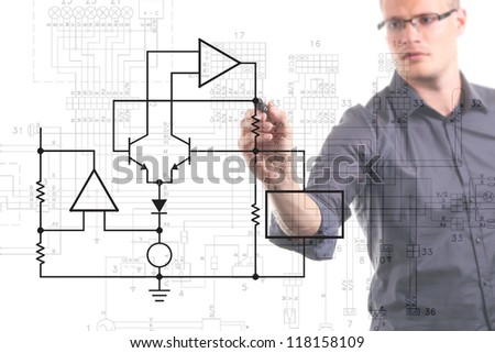 electrical engineer drawing circuit diagram on the whiteboard