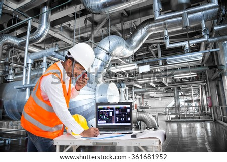 Electrical engineer working at control room of a modern thermal power plant
