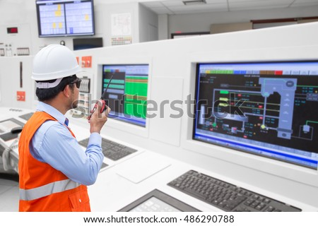 Electrical engineer working at control room of a modern thermal power plant #486290788