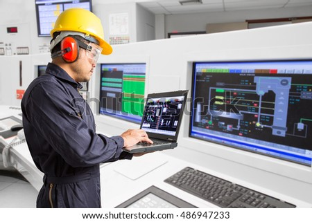 Electrical engineer working at control room of a modern thermal power plant #486947233