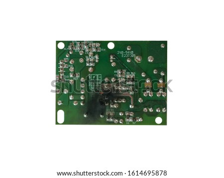 Electrical equipment board circuit damage from short circuits or lightning strikes on white background with clipping path. selective focus.