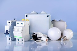 Electrical equipment on blue background. Various electric products on the store shelve.