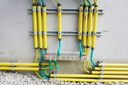 Electrical high voltage ground copper bar on wall. Grounding electric bar. Cables connected to electrical grounding bar, Ground industry for control system.