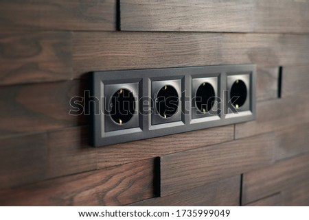 Electrical household switches and sockets close up. Minimalist interior design. Stylish bedroom and living room. Wooden bricks wall in a designer minimalist room. Wooden parquet room. Scandinavian Сток-фото ©