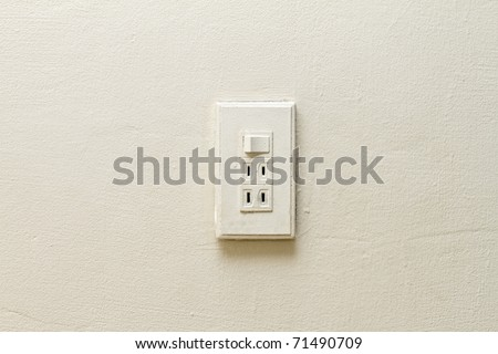 Electrical light and switch on the white wall socket.