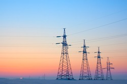 Electrical mast morning snow sunrise voltage cables
