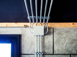 Electrical metal conduit work Installation. Electrical wires running across the wall and ceiling. Loft style.