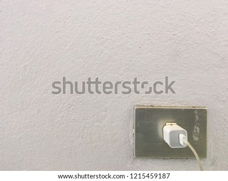 Electrical outlet install on cement wall.