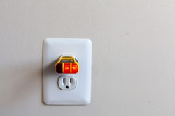 Electrical outlet tester also known as plug tester is a small device that is used to confirm proper wiring and electric current in a plug. Two yellow lights indicate active plug.