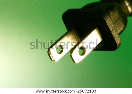 electrical plug against green background