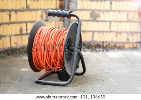 Electrical power extension cable reel at the repairs site #1011136630