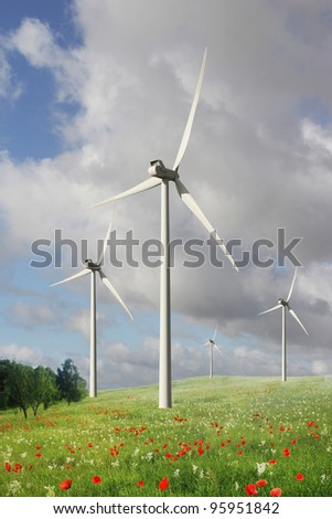 Electrical power generating wind turbines on a beautiful landscape.
