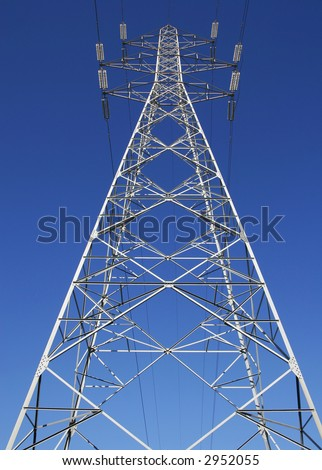 electrical power line tower agaist clear blue sky