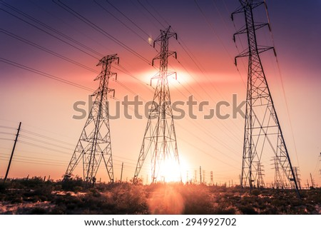 Electrical power lines as sun sets in background