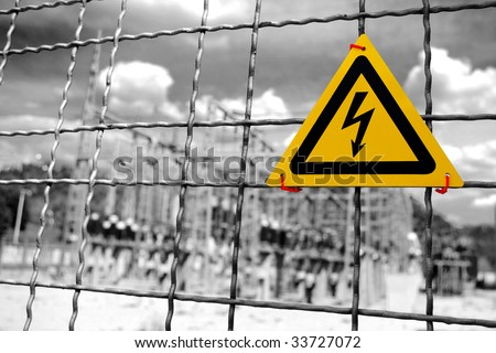 Electrical power plant with High Voltage sign in a fence